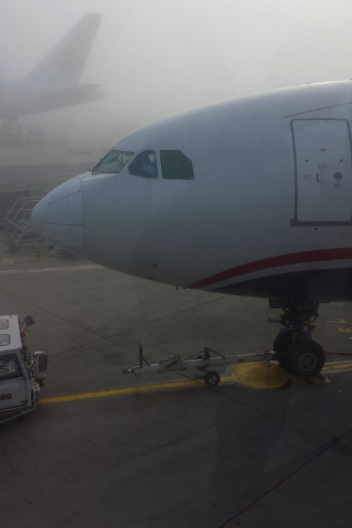Photo of the forward section of a plane in a foggy airport