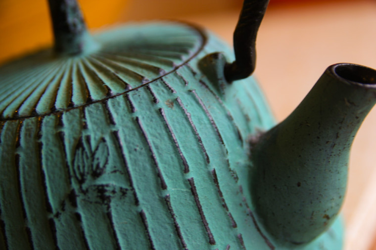 Close-up on a green Japanese Cast Iron Tea Kettle