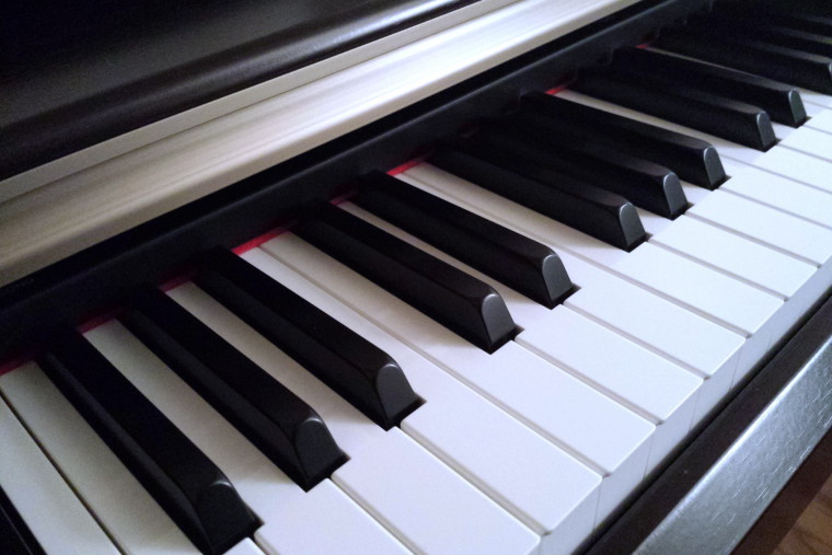 Close-up photo of the keys of a piano